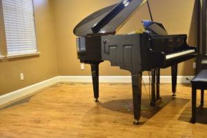 Hardwood floor under piano